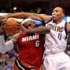 James and Wade power Heat past Mavericks in opener