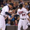 Thome leads Phils over Twins, 6-1