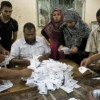 Egypt starts counting votes as military expands powers