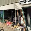 Van crashes through building in Spirit Lake