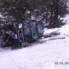 Iowa man fails at u-turn, car topples down hill