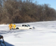 Emergency responders pull person out of truck in icy Clear Lake