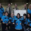 Dames of Anarchy make donation to Crimestoppers