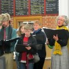 Carolers spread cheer at library