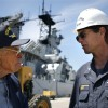Ex-Iowa sailors salute the ship as it makes its final port call