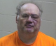 Iowa man charged with attempted murder of sheriff after ramming police car with tractor outfitted with front-end bale spear