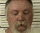 Northern Iowa felon sent to prison for unlawfully possessing over a dozen guns