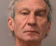 Iowa man refuses to leave relative's home, points gun at cops, who then flee