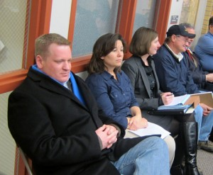 A smug Eric Bookmeyer waits for his victory at a North Iowa Landfill Board meeting last year.  That victory never came.