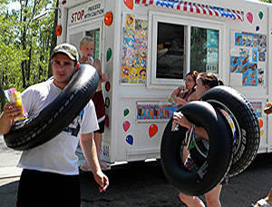 Kids enjoy ice cream from an ice cream delivery truck in Mason City in July of 2012.