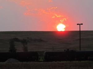 A freight trail full of tanker cars hauling crude oil crosses the plains near Trenton, North Dakota, on August 23, 2012.  Oil may be losing ground to solar as an energy source.
