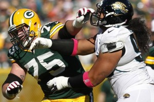 The Green Bay Packers' Bryan Bulaga blocks the Jacksonville Jaguars' Tyson Alualu during the third quarter at Lambeau Field in Green Bay, Wisconsin, Sunday, October 28, 2012. The Packers beat the Jaguars, 25-15.