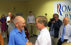 Virginia Governor Bob McDonnell greets a man who says he is a World War II vet as former Mason City Mayor Bill Schickel looks on.