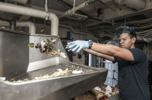 Aviation Ordnanceman Airman Chris Lewis sorts food trash in the pulping room aboard the amphibious assault ship USS Peleliu (LHA 5). Peleliu is the flagship for the Peleliu Amphibious Ready Group and, with the embarked 15th Marine Expeditionary Unit, is deployed in support of maritime security operations and theatre security cooperation efforts in the U.S. 5th Fleet area of responsibility. (U.S. Navy photo by Mass Communication Specialist 3rd Class Van't Leven)