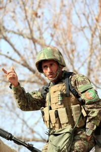Captain Abdul Hadi, commander of 2nd Tolay, 1st Kandak, 2nd Brigade, 215th Corps, and a native of Takhar province, coordinates with his soldiers in an effort to prepare them for the days tasks during Operation New Hope, Kajaki, Afghanistan, Jan. 17. During the three-day operation, more than 100 Afghan National Army soldiers along with various Afghan National Security Forces elements cleared weapons caches, improvised explosive devices and enemy fighting positions from the area. Accompanying the ANA were 18 Marine advisors providing call for fires and tactical input when needed. Afghan National Security Forces localized their efforts to Kajaki Sofala, part of the southern green zone in Kajaki and a known insurgent hotbed in the district.