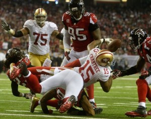 San Francisco 49ers wide receiver Michael Crabtree (15) fumbles at the goal line which was recovered by Atlanta Falcons outside linebacker Stephen Nicholas (54) during the second half of the NFC Championship game at the Georgia Dome in Atlanta on January 20, 2013. UPI/Richard Hamm