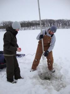 ISU graduate student Adam Heathcote and undergraduate assistant Kelli Rae Soll collect a sediment core from a lake in northwestern Iowa.  Courtesy of John Downing.