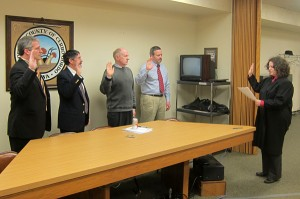 Judge Colleen Weiland, far right, swears in elected officials Tuesday morning.