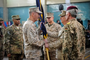 Marine General Joseph F. Dunford assumes command of International Security Assistance Force (ISAF), from Gen. John Allen at a Change of Command Ceremony in Kabul Afghanistan on February 10, 2013.