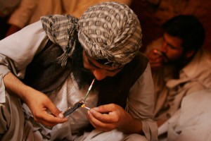 A heroin addict smokes in the Old City in downtown Herat, Afghanistan on August 13, 2009. The poppy fields of Afghanistan are the source of most of the world's heroin supply and the source of the Taliban's power and money. UPI/Mohammad Kheirkhah.
