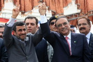 Iranian President Mahmoud Ahmadinejad (L) holds hands of Pakistan's President Asif Ali Zardari (R) during the inauguration ceremony of a Iran-Pakistan gas pipeline project on, in Chabahar Iran on March 11, 2013. Iranian President Mahmoud Ahmadinejad and Pakistan President Asif Ali Zardari have officially inaugurated the Iran- Pakistan gas pipeline project. UPI/Hamid Forotan/ISNA