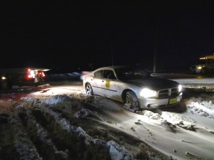 Iowa State Trooper getting towed out of snow drift on Apple Ave