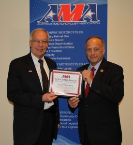 King receives the AMA Supporter Award from former Senator Wayne Allard, VP of Government Relations