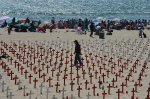 A man walks amid crosses on display at the Arlington West Memorial Project in Santa Monica, California.  The beach memorial represents the 4,486 soldiers killed in Iraq and 1,984 killed in Afghanistan for a total of 6,470 dead in both wars. UPI/Jim Ruymen