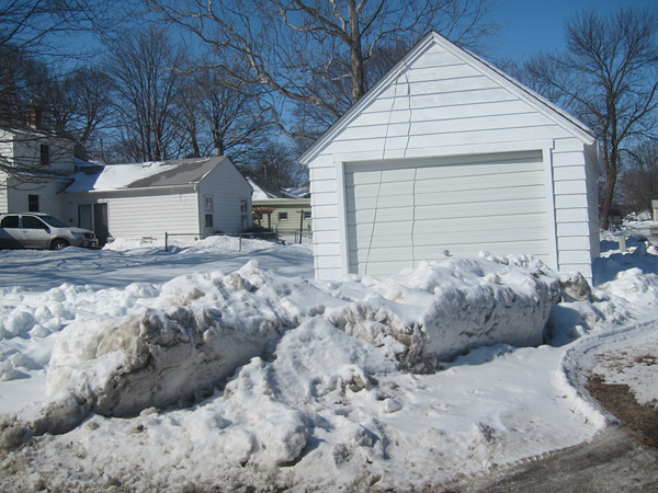 Cheryl Gerk's drieway, with a large pile of snow in it.