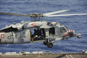 An MH-60S helicopter assigned to Helicopter Sea Combat Squadron (HSC) 6, aboard USS Nimitz (CVN 68).