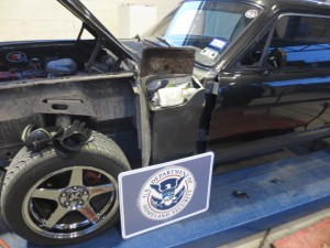 The vehicle was dismantled and specially constructed compartments were discovered under the front fenders of the car.