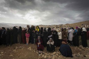 Syrian refugees queue to be registered on the outskirts of the Lebanese town of Arsal. Photo: UNHCR/M. Hofer