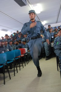 A graduate of Afghan Uniform Police training marches to receive his diploma during a graduation ceremony Aug. 12 in Regional Training Center - Kandahar.
