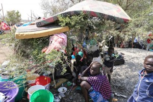 Displaced civilians with some of their only possessions take refuge at UN House. UN Photo/Isaac Billy