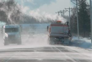 Snowplows on still drifting Highway 65 North of Mason City