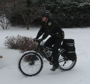 This bicycle, a Salsa Cycles Mukluk 3, will be utilized by the officer assigned to patrol of the Iowa City Downtown District. The use of this bicycle allows the officer to carry more equipment than is practical on foot patrol, respond more quickly to calls for service, and have increased safety compared to a traditional mountain bike.