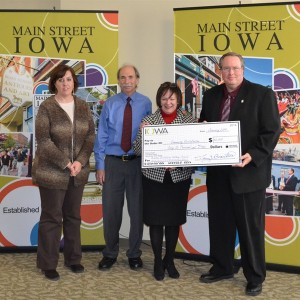 Representatives from Charles City accept a check on January 7, 2014