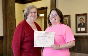 Waldorf College education major Erin Larsen (right) holds her certificate for scoring in the top 15% on the PRAXIS Content Knowledge exam poses with her advisor, Associate Professor of Education Dr. Rebecca Hill (left).