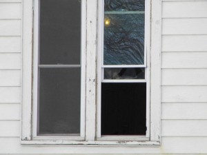 Upstairs window broken where it was said that things were being thrown from