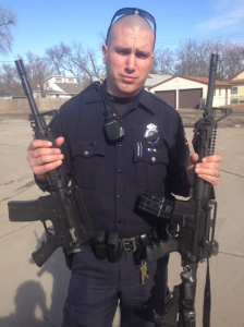 Officer Chris Groth shows difference between toy and real gun (Omaha police social media)