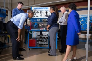 President Barack Obama, Vice President Joe Biden, and Commerce Secretary Penny Pritzker tour a classroom at the Community College of Allegheny County West Hills Center in Oakdale, Pa., April 16, 2014. Students Zach Kuzma and Stephanie Womack demonstrate equipment that teaches students how to manipulate gears, pulleys, sprockets, etc. to adjust the speed and/or torque of a motor or system. (Official White House Photo by David Lienemann)