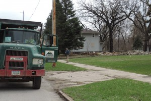 McKinness Excavating works on tearing down a flood house on April 22, 2014