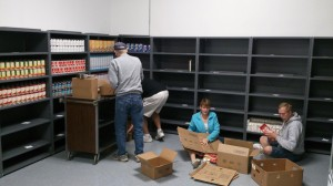 Volunteers stock shelves at new location (Facebook.com)