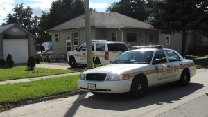 Law enforcement at Hoffman's house from previous attempt to arrest him