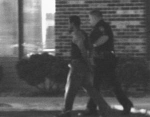 Handcuffed suspect.  They need jobs, too.