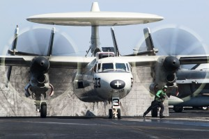 A U.S. Navy E-2C Hawkeye aircraft assigned to Carrier Airborne Early Warning Squadron 124 takes off from the flight deck of the aircraft carrier USS George H.W. Bush in the Persian Gulf, Oct. 2, 2014. U.S. Navy photo by Petty Officer 3rd Class Lorelei Vander Griend