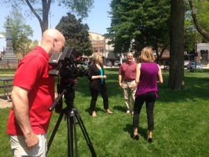 Caroline Lowe and Jay Alberio being interviewed by Liz Collin of WCCO at Mason City's Central Park.