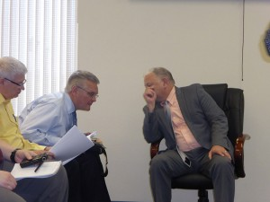 Attorney Randall Nielsen confers with City Administrator Brent Trout