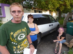 """The Joyce family, Patrick, Tammy and daughter Gemini.  She says she is """"just visiting"""" from Milwaukee, while park management says she is banned """"for a lot of reasons""""."""