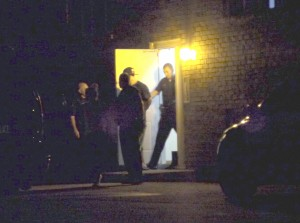 Caught by police: Hester is taken out of Jean Marinos' apartment house